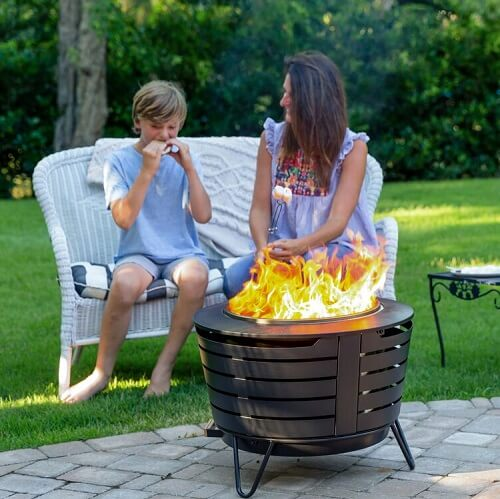 mother and son by fire pit