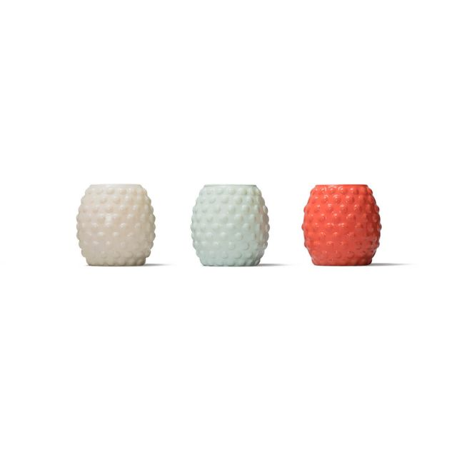 seaside escape bubble glass tiki wax candles up close white background