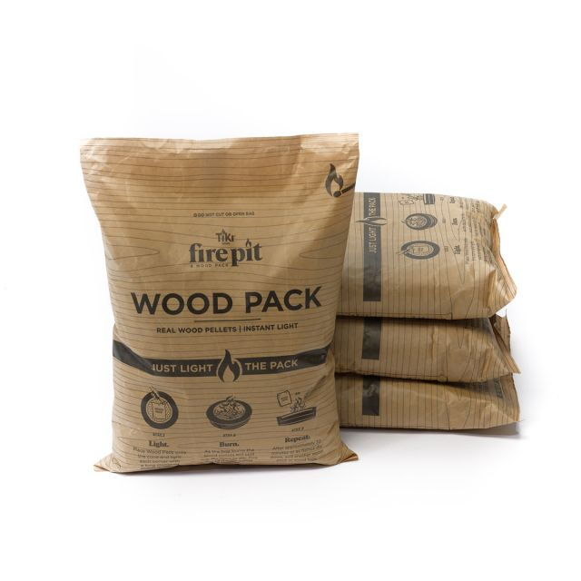 stack of 3 tiki fire pit wood pack bags and 1 wood pack in front
