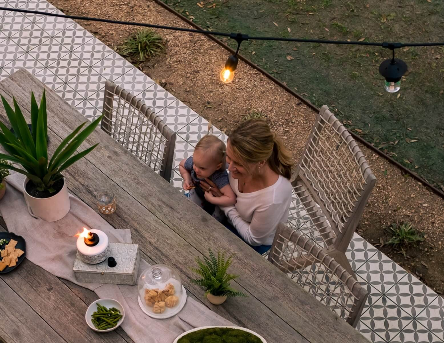 eating outdoors under string lights